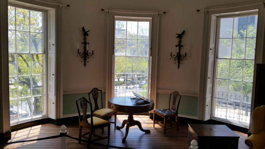 A color photograph of the circular room above the entrance to the POctagon House, Washington D.C. Behind the point of view is the staircase where lives were lost, and a ghost or tow still haunt.