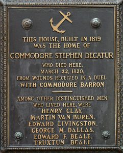 Photo of a brass plaque on the outside of the Decatur House, Washington D.C. It reads 'Decatur House Museum, a property of the national Trust for historic preservation, 748 Jackson Place'
