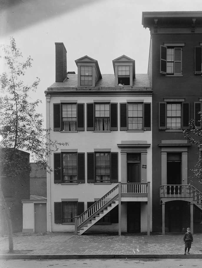 Exterior black and white photograph of the Surratt House, in Washington D.C.
